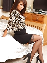 Laura P in leopardprint silk & black skirt