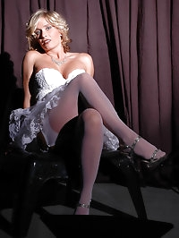 Lusty darling in ruffled white dress