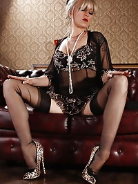 Sexy blonde lady Alina in Black lingerie and stockings