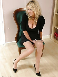Horny blonde in a sleak black dress with matching high heels