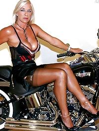 Leggy MILF Astrid gets horny on a Harley