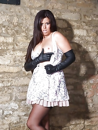 Sexy Leanne knows how to put a pair of leather gloves on..