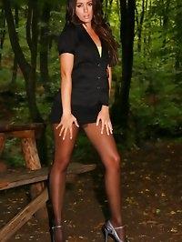Cute brunette Natalia wearing miniskirt and black pantyhose.