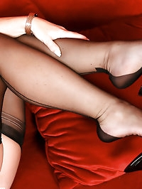 Horny Annabelle in FFS stockings masturbates of the sofa