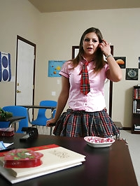 Busty brunette teen rides a cock on her teachers desk