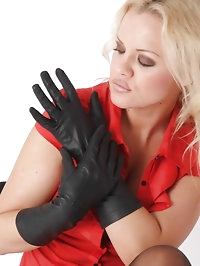 Such a sexy blonde with some amazing leather gloves on