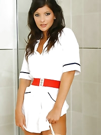 Sexy brunette Lou L wearing a nurse's uniform with tan..