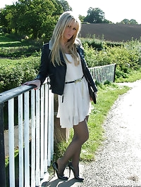 Gorgeous blonde Erin is outdoors showing off her shiny..