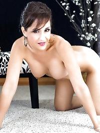 Splendid brunette mom showing her feet in pantyhose