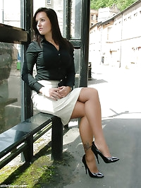 Sexy brunette in a tight skirt, with long stockinged legs..