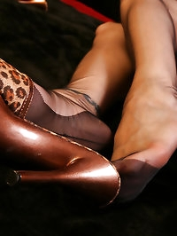 Amazing redhead Nadja show her nylon covered soles in rar..