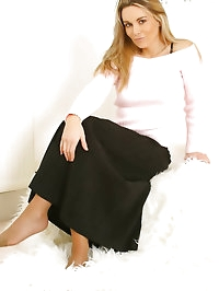 Busty beauty Kelly secretary in tan stockings.