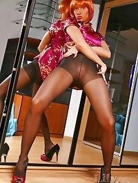 Beautiful redhead leggy MILF in sexy black pantyhose