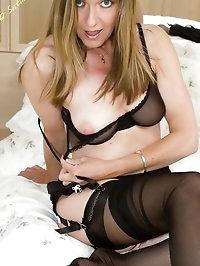 sheer nylon lover poses on bed