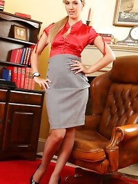 Hot blonde secretary in a red silk blouse and tight grey..