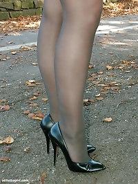 Hot brunette Sara is posing outdoors in her silky black..
