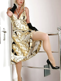 Glamour Puss Astrid in shiny pantyhose masturbates after..