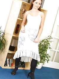 Brunette Jana B wearing a evening dress with black opaque..
