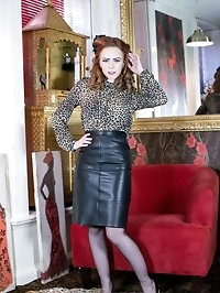 Saucy redhead Ella in racy blouse and leather pencil..