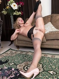 Olga certainly likes to get herself off in many positions,..
