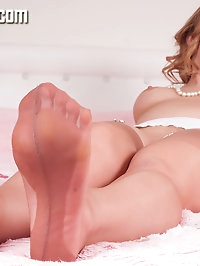 A very feminine Sophia presents in a mini slip and sexy..