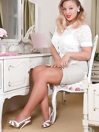 Lovely Beth is in the bedroom at her dressing table,..