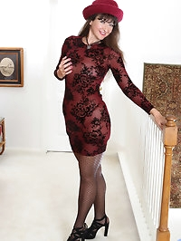 An evening gown and sheer thigh high stockings make..