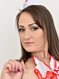 Naughty nurse Angel Karyna spreads her legs in thigh high..