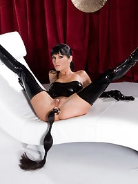 Perfect model in latex stockings fucked by three big dicks