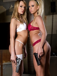 Sexy Carla and Vivien hold guns and want to fuck hard cock