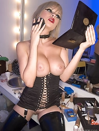 Smoking bitch in black lingerie has big boobs and cute face