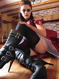 Sexy brunette all dressed up in kinky gear sits on guys face