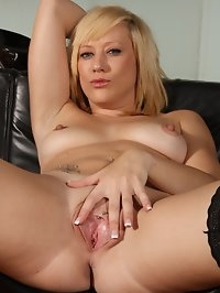 Axa Jay strips to her stockings to fuck herself with her toy