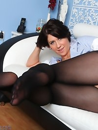 Nurse Lilly plays in her uniform and black pantyhose
