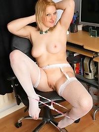 Minnie masturbates in the office in white fishnets
