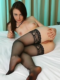 Cute Kacie in stockings fucks herself with her dildo