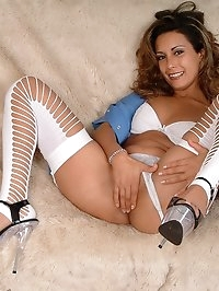 Anais in nurses uniform and stockings as she fingers herself