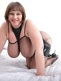 Huge breasted Carol Brown loves playing with her toys