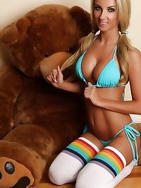Busty blonde Alluring Vixen babe Aneta teases in a skimpy..