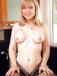 Sultry Anilos Nina Hartley teases her wet pussy in the..