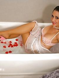 Brunette wet MILF in stockings has fun in bathroom