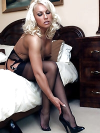 Sexy blonde bombshell Lana takes off her work suit nice..