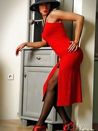 Passionate lady in red and sexy black stockings