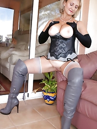 Sexy babe wears huge boots and stockings