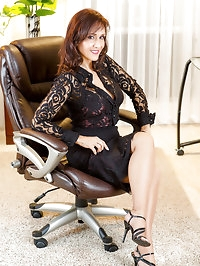 Alluring and hot brunette mom in the office