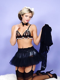 Sexy blonde maid wearing sexy lingerie makes her tidying..