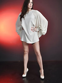 Jane looks stunning in her short white dress and high heels