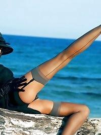 Luxury leggy MILF in classy black nylons and stilettos