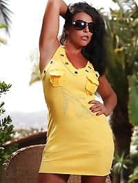 Leggy babe in a yellow dress