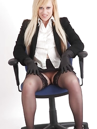 Axa showing off her sexy office suit and horny leather..